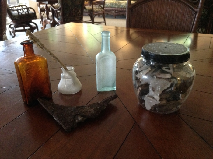 """Jar of melted glass fragments from glass ware, windows, etc., at Oak Lodge."""