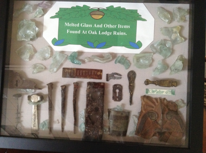 """Melted Glass and Other Fragments Found at Oak Lodge Ruins."""